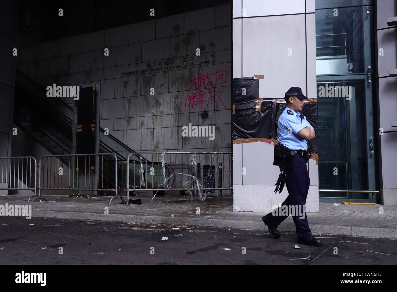Hong Kong. 22nd June, 2019. Policeman walk path trashed up Hong Kong Police Headquarters in the early morning after thousand of demonstrators surrounded Police Headquarter condemning police brutality, demanding Police Chief Lo Wai-chung to offer formal apologies to the public. So far Lo have not responded to the public outcry.June-22, 2019 Hong Kong.ZUMA/Liau Chung-ren Credit: Liau Chung-ren/ZUMA Wire/Alamy Live News - Stock Image