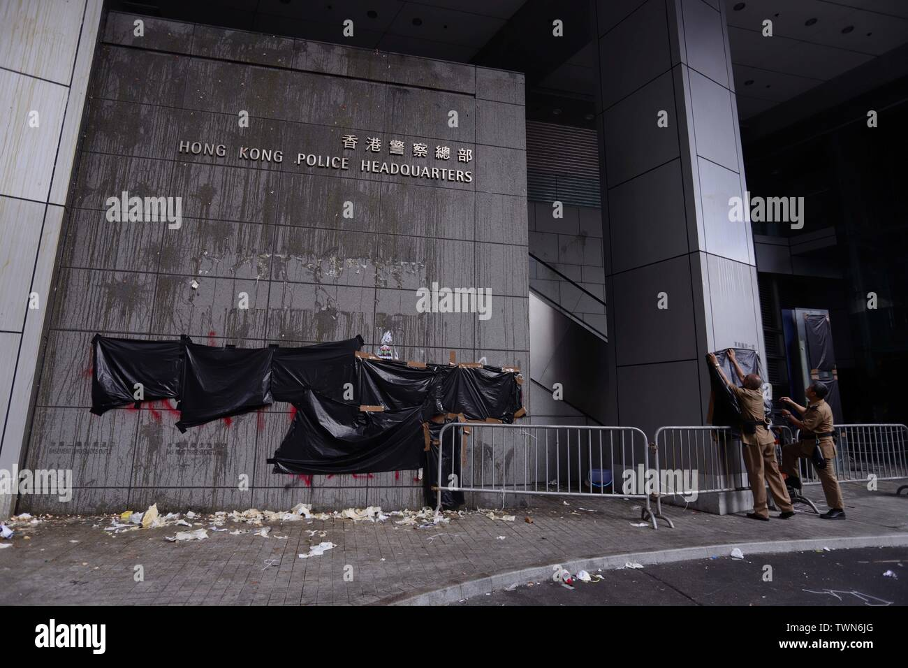 Hong Kong. 22nd June, 2019. Servicemen try to cover up political slogans outside severely trashed Hong Kong Police Headquarters in the morning after thousand of demonstrators surrounded Headquarters last night demanding Chief of Police Lo Wai-chung to show up and offer apologies to the citizens.June-22, 2019 Hong Kong.ZUMA/Liau Chung-ren Credit: Liau Chung-ren/ZUMA Wire/Alamy Live News - Stock Image