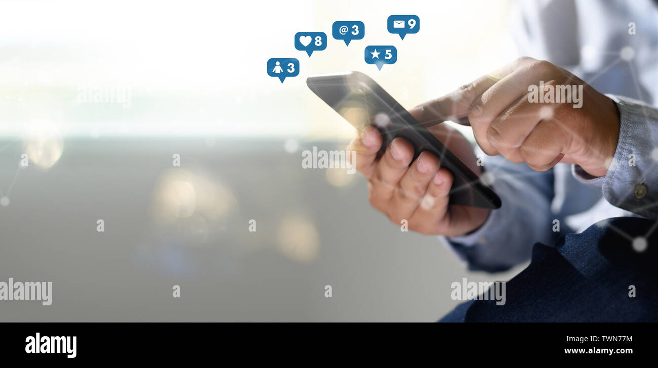 Social media,social network concept with smart phone  man phone with social media network diagram - Stock Image