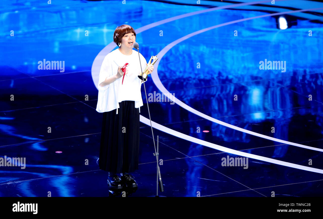 (190622) -- SHANGHAI, June 22, 2019 (Xinhua) -- Japanese filmmaker Yuko Hakota speaks to the audience after receiving the best director award at the Asian New Talent Award section of the 22nd Shanghai International Film Festival in Shanghai, east China, June 21, 2019. 'To Live To Sing,' a Chinese film about traditional Sichuan opera, won the best film award at the Asian New Talent Award section of the 22nd Shanghai International Film Festival Friday. The best director award was presented to Japanese filmmaker Yuko Hakota for her film 'Blue Hour,' and the best screenplay award went to Indon - Stock Image