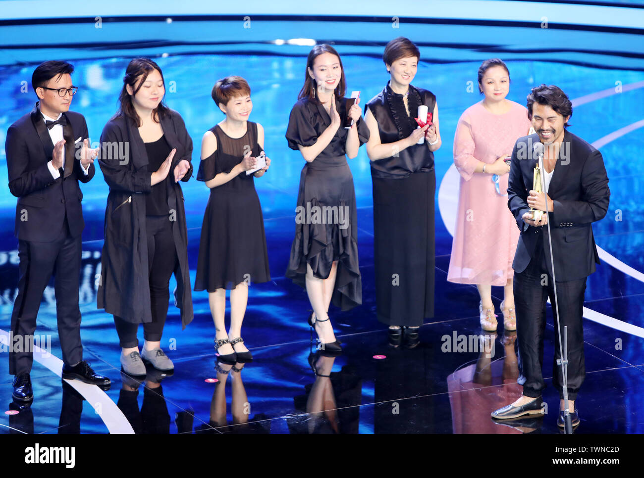 (190622) -- SHANGHAI, June 22, 2019 (Xinhua) -- Cast members of the Chinese film 'To Live To Sing' attend the Asian New Talent Award section of the 22nd Shanghai International Film Festival in Shanghai, east China, June 21, 2019. 'To Live To Sing,' a Chinese film about traditional Sichuan opera, won the best film award at the Asian New Talent Award section of the 22nd Shanghai International Film Festival Friday. The best director award was presented to Japanese filmmaker Yuko Hakota for her film 'Blue Hour,' and the best screenplay award went to Indonesian film 'Mountain Song.' The As - Stock Image