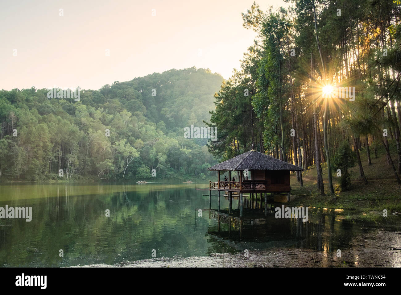 Cottage beside reservoir serene at sunset,pang oung,mae hong son,thailand - Stock Image