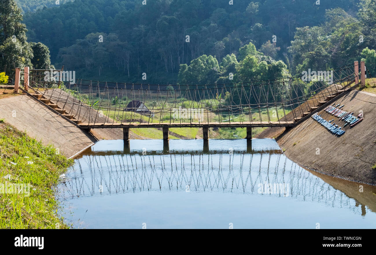 Wooden bridge over on reservoir at pang oung - Stock Image