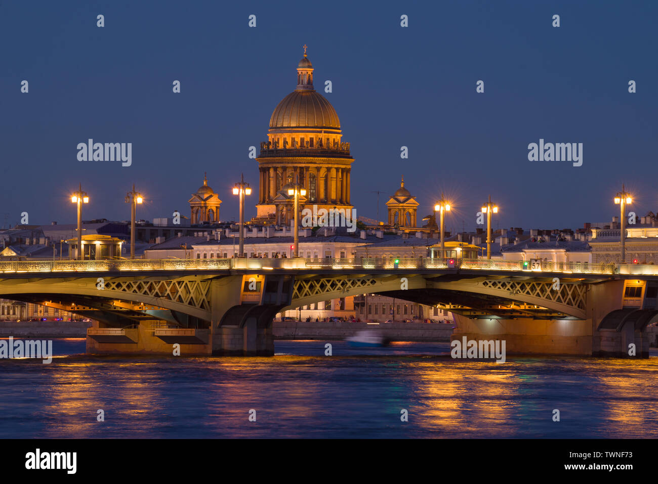 The dome of St. Isaac's Cathedral over the Blagoveshchensk bridge on a white night. Saint-Petersburg, Russia - Stock Image