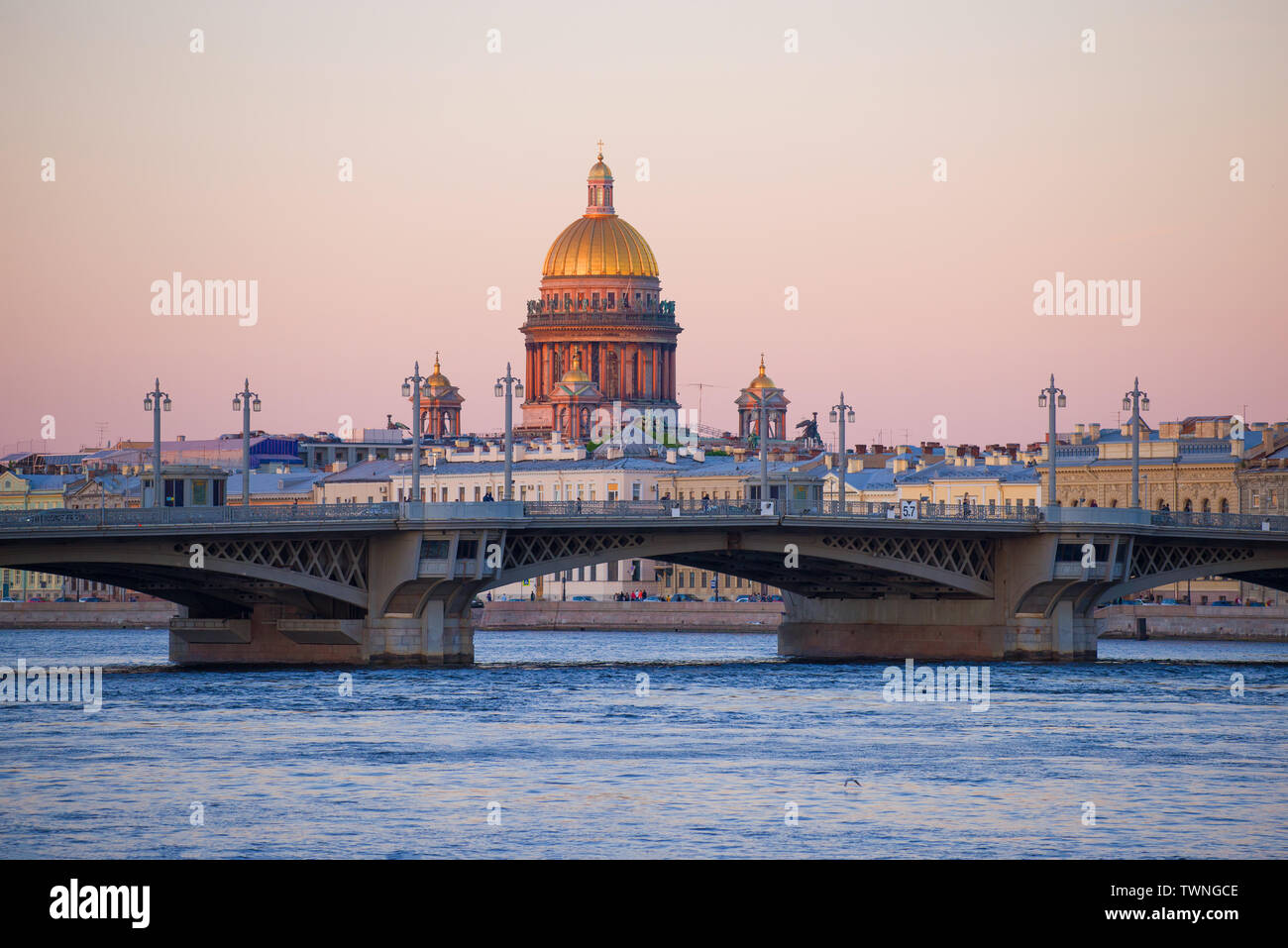 Dome of St. Isaac Cathedral over  Annunciation Bridge in May twilight. St. Petersburg, Russia - Stock Image