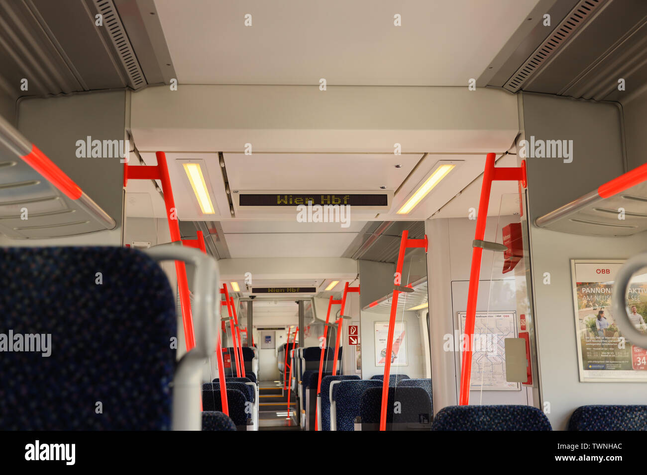 Inside of a regional Austrian train that commutes from Eisenstadt to Vienna. The commuted train is operated by OEBB (Austrian Railways) - Stock Image