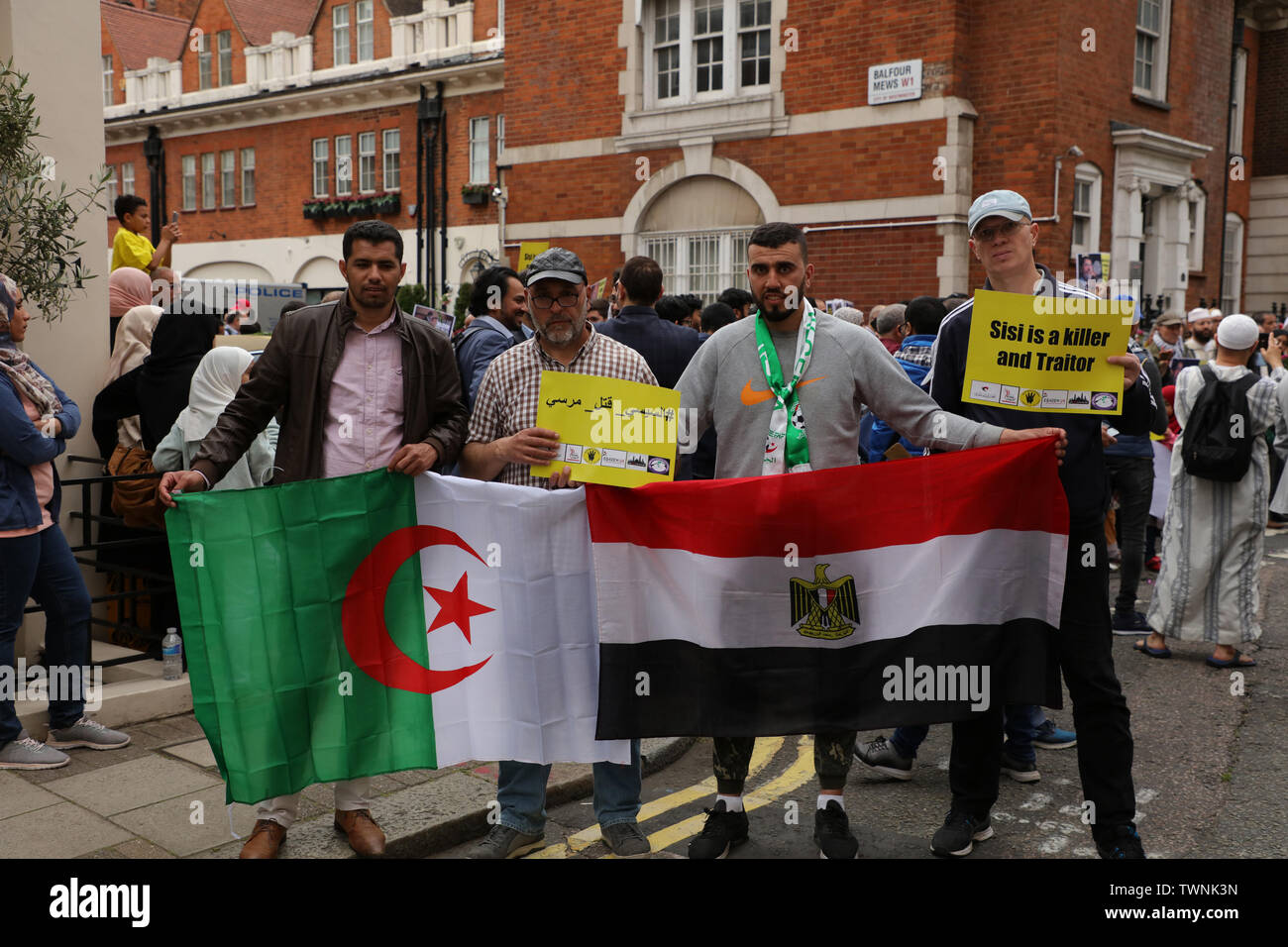 London, UK. 21st June 2019.  Protesters in front of the Egyptian embassy in London, with the Algerian and Egyptian flags, in remembrance of Morsi, who recently collapsed in court in Cairo. Credit: Joe Kuis / Alamy News Stock Photo