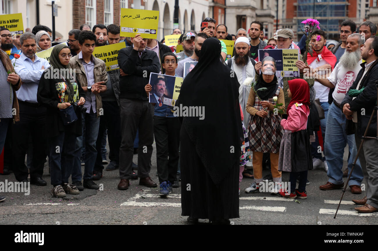 London, UK. 21st June 2019. Those attending a protest in front of the Egyptian embassy in London, in remembrance of Morsi, who recently collapsed in court in Cairo, listen to one of the several speakers of the event. Credit: Joe Kuis / Alamy News Stock Photo