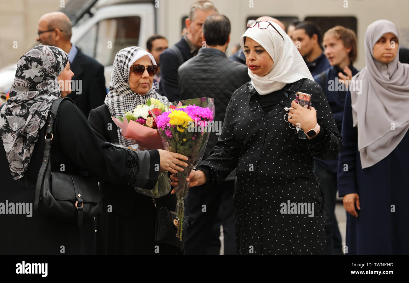 London, UK. 21st June 2019. Some of those who attend a protest in front of the Egyptian embassy in London, in remembrance of Morsi, who recently collapsed in court in Cairo, distribute flowers among the demonstrators. Credit: Joe Kuis / Alamy News - Stock Image