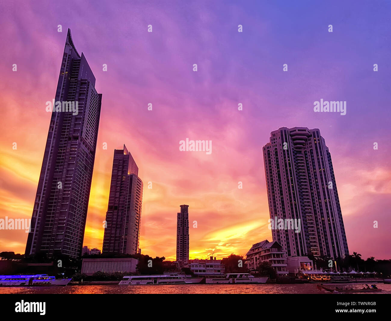 beautiful Bangkok city view with high building at riverside at the dusk with colorful of twilight sky in the evening after sunset time - Stock Image
