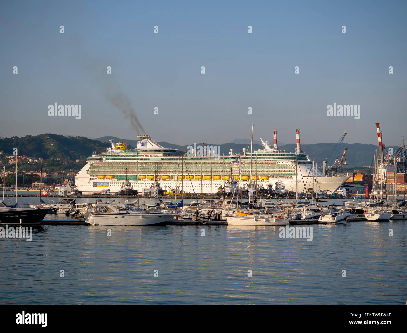 LA SPEZIA, ITALY JUNE 21, 2019: Beautiful evening, a cruise ship leaves La Spezia port for its next destination. Independence of the Seas, Royal Carib - Stock Image