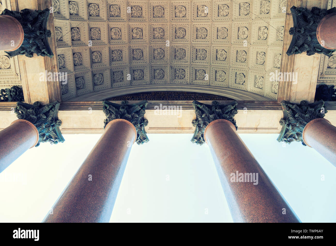 Architecture background with columns under sunlight. St Isaac Cathedral colonnade in St Petersburg, Russia. Vintage filter applied - Stock Image