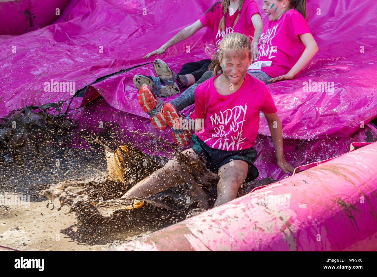 Abington Park, Northampton, U.K. 22nd June 2019. Race for Life Pretty Muddy, raising funds for Cancer Research, a 5km obstacle route which meanders through the very scenic Abington Park, over 1700 people of all ages taking part this morning  in 15 mins waves raising £164,400 for Cancer Research. Credit: Keith J Smith./Alamy Live News. - Stock Image