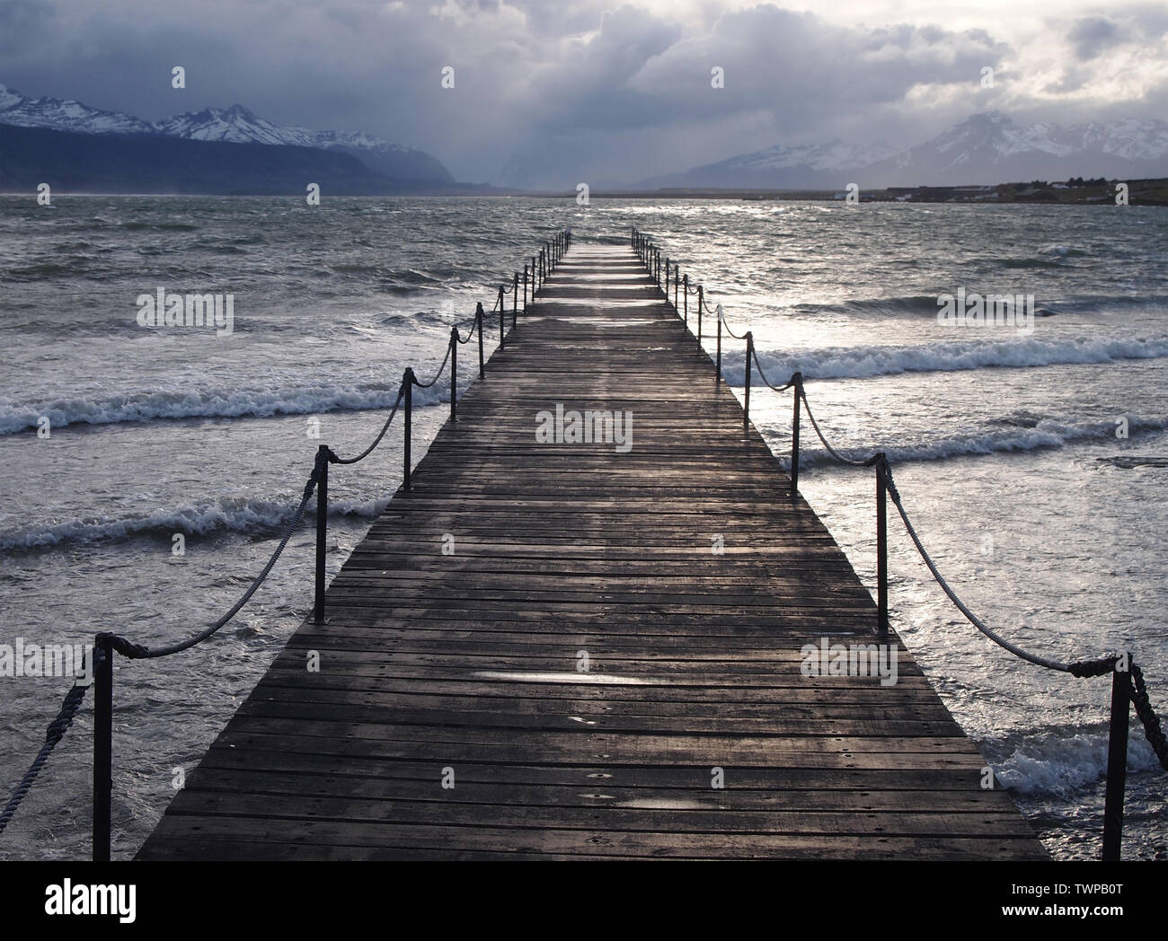 Wooden pier in Puerto Bories, Ultima Esperanza Bay, near the city of Puerto Natales in Southern Chile - Stock Image