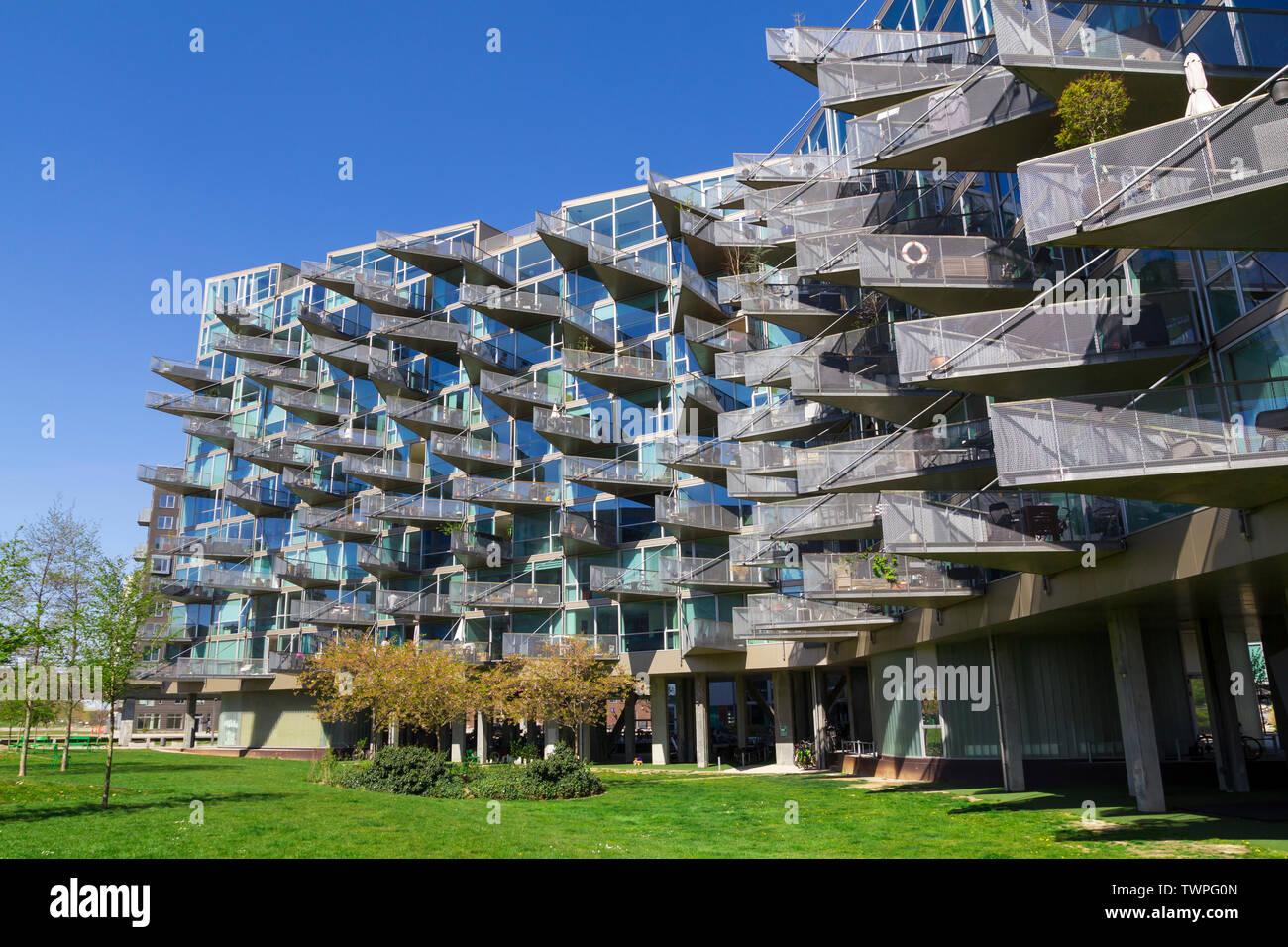 Modern architecture building in Orestad, Copenhagen, with triangular balconies in a glass facade Stock Photo
