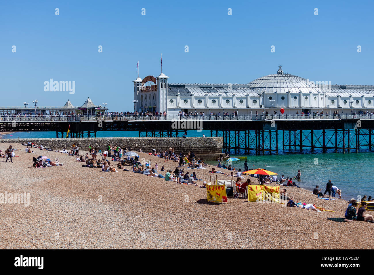 Brighton, UK. 22nd June 2019: After a week of unsettled weather, families managed to get a sun filled day on Brighton Beaches Credit: SEUK News/Alamy Live News - Stock Image
