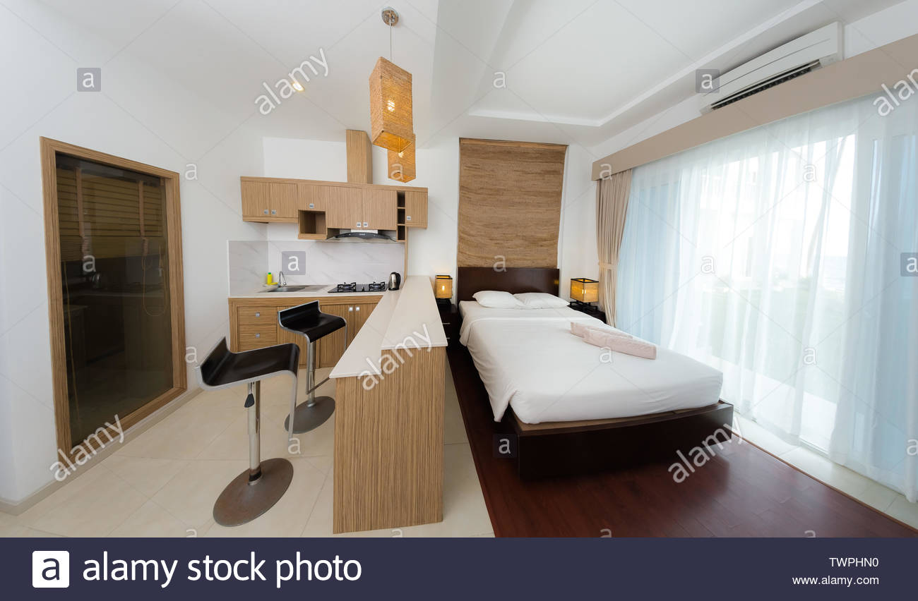 Comfortable Studio Apartment Design Hotel Room Interior With Bedroom Area Living Space And Kitchen Corner Stock Photo Alamy