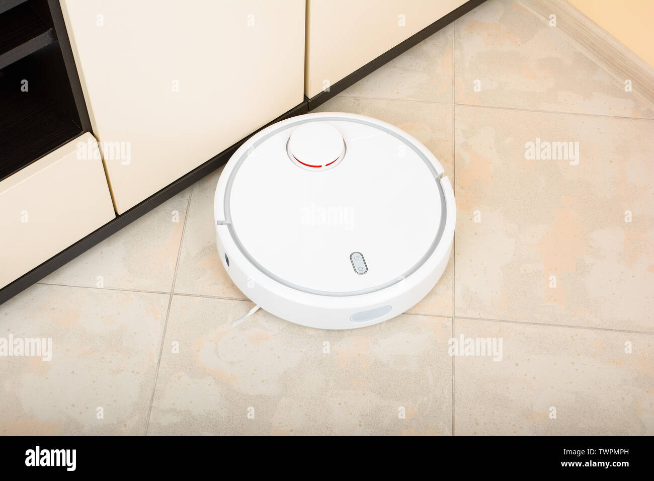 Vacuum Cleaner Robot On Polished Granite Floor In A Living Room Stock Photo Alamy
