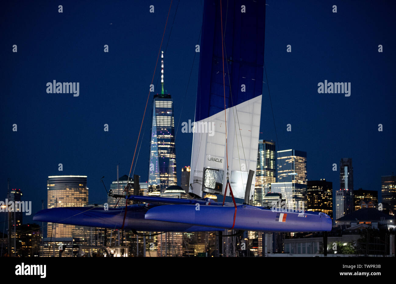 SailGP Team France crane their race yacht ashore in New Jersey following the first day of racing today. Event 3 Season 1. SailGP New York City, New York, United States. Stock Photo
