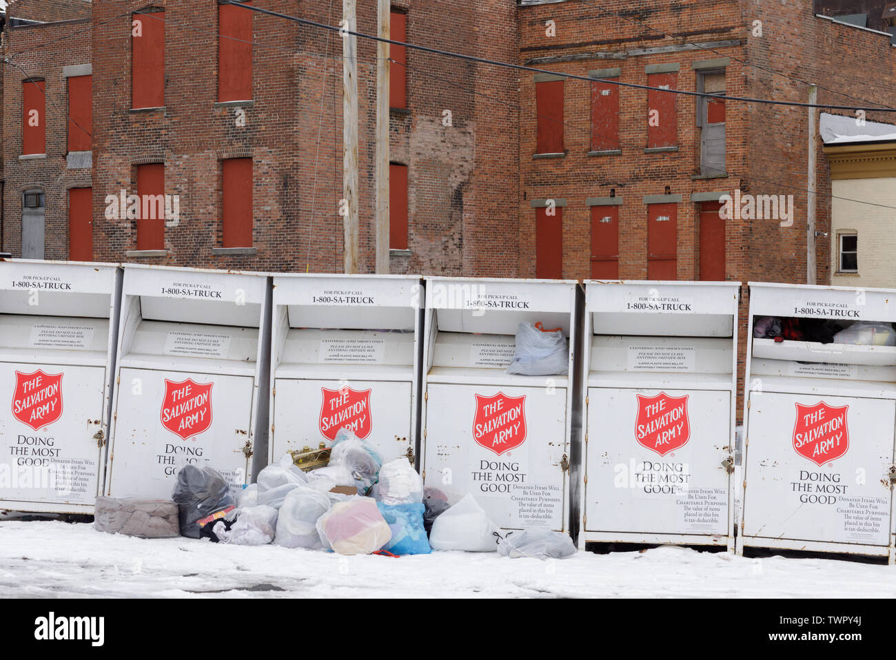 Salvation Army collection boxes overflow with donations. Gloversville, New York State, USA. - Stock Image