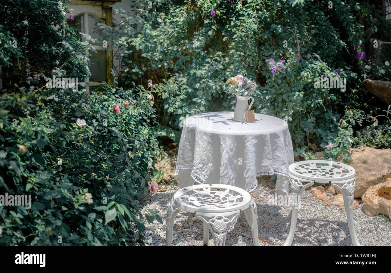 outdoor teatime table chair decor garden exterior house background TWR2HJ