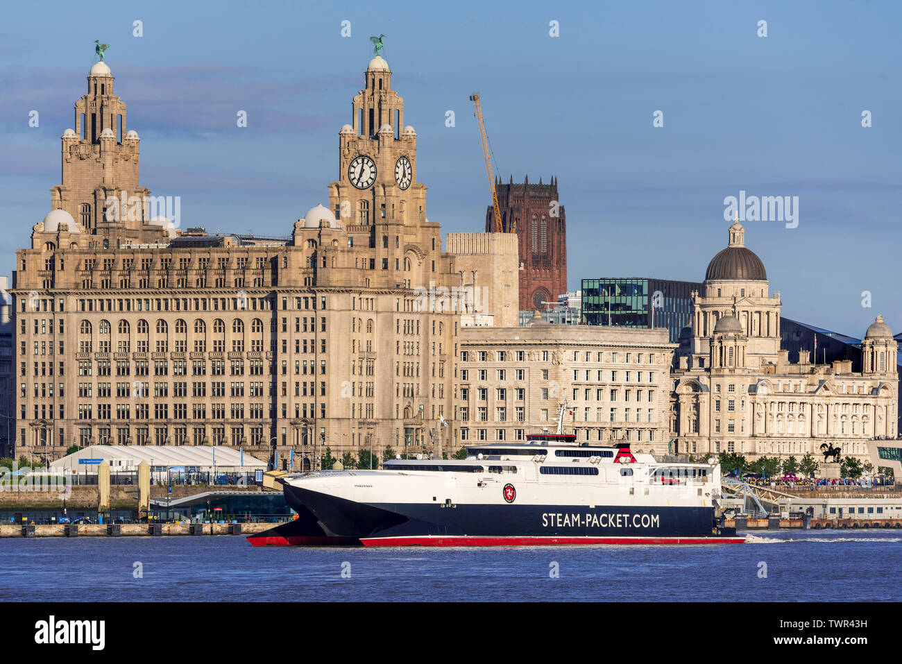 Isle of Man Ro Ro car ferry catamaran the Manannan in the river Mersey at Liverpool pierhead. The Royal Liver building. Stock Photo