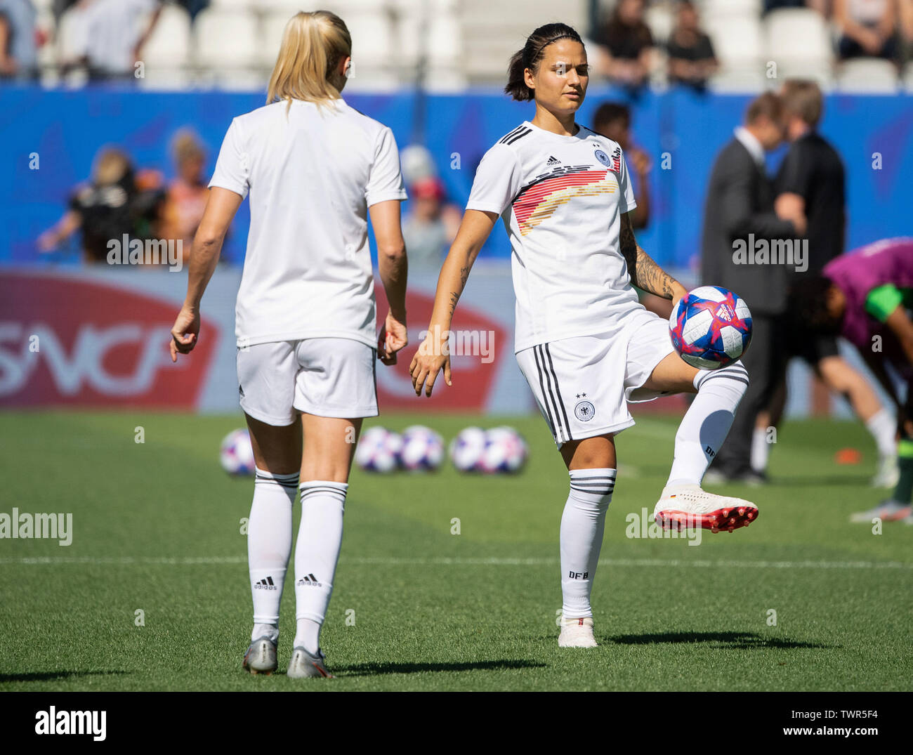 France 22 June 2019, (France), Grenoble: Football, women: WM, Germany - Nigeria final round, round of sixteen, Stades des Alpes: Germany's Dzsenifer Marozsan (r) warms up with Turid Knaak before the game. Germany won 3:0. Photo: Sebastian Gollnow/dpa - Stock Image