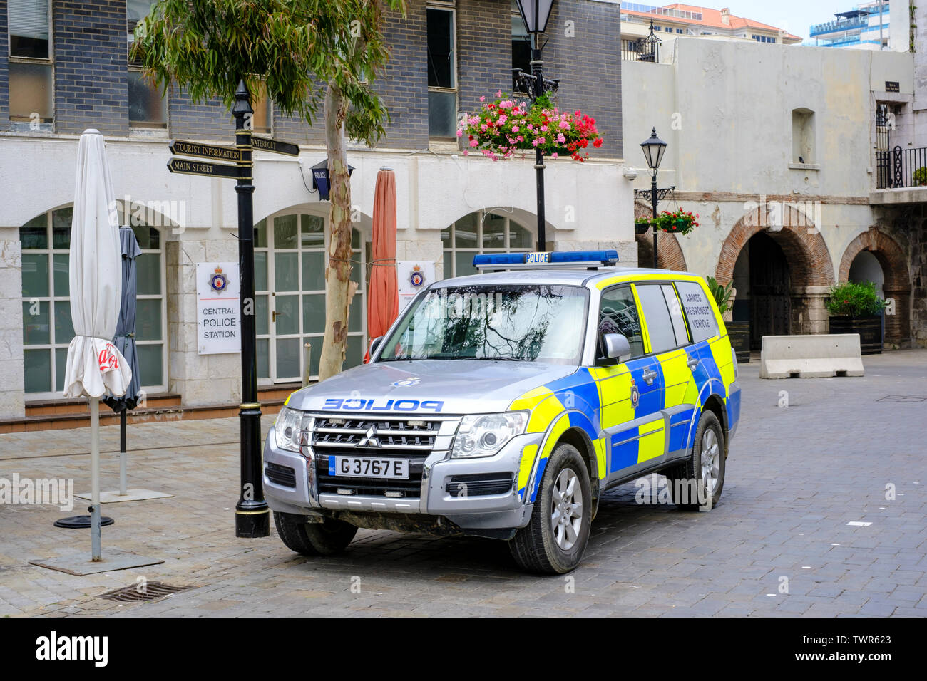 Royal Gibraltar Police, Central Police Station, Casemates Square in the centre of town with an armed police response vehicle parked outside - Stock Image