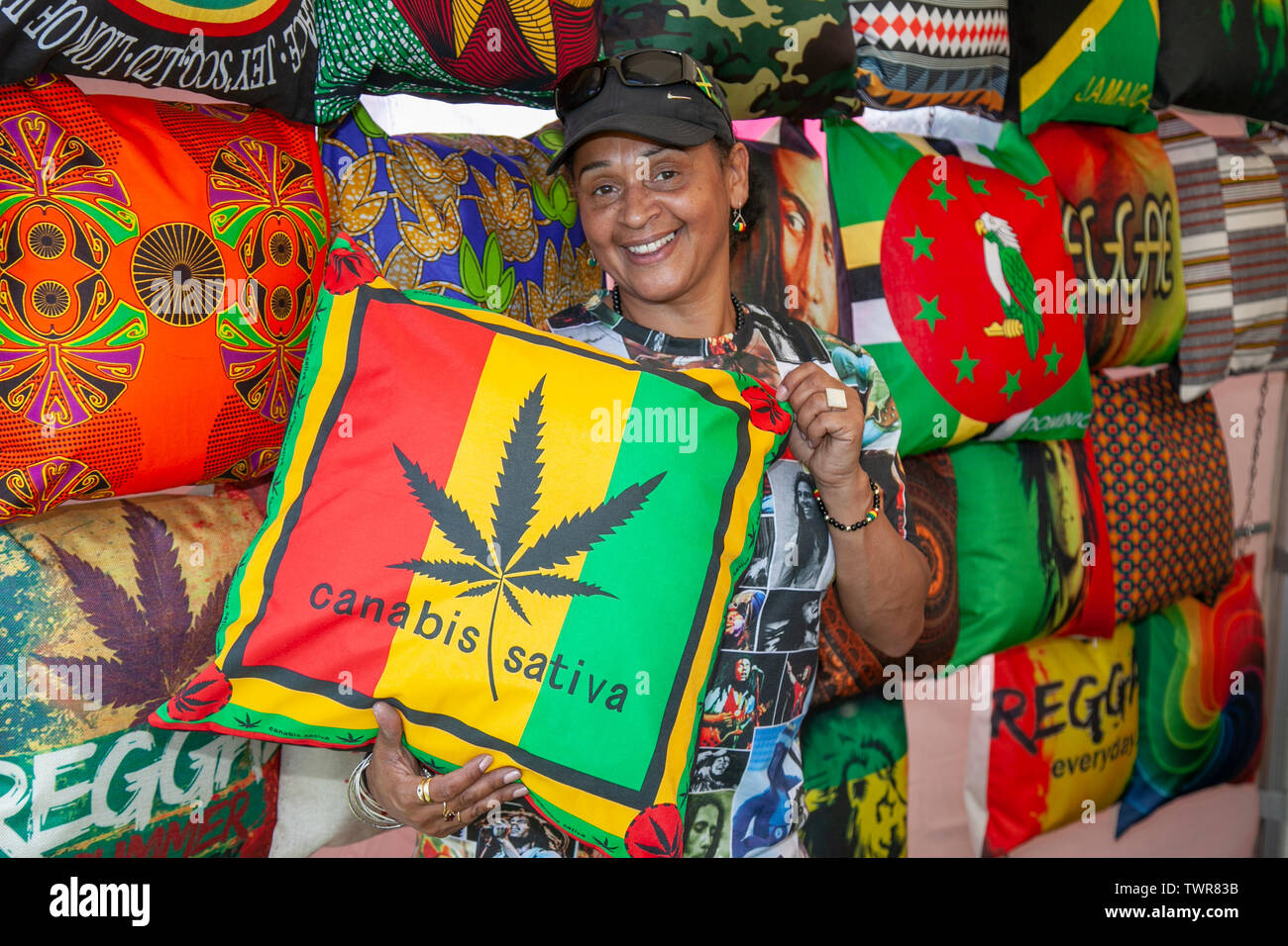 Liverpool, Merseyside, UK. 22nd June 2019. Patricia Hall a cushion trader at the Africa Oye Music Festival.  Music lovers, vendors, attend the fantastic Africa Oyé Festival in Liverpool's Sefton Park. The UK's largest free celebration of African music and culture, goods, traders & merchandise brings out the crowds to enjoy the entertainment as festival-goers bask in the sun. Credit: MWI/Alamy Live News - Stock Image