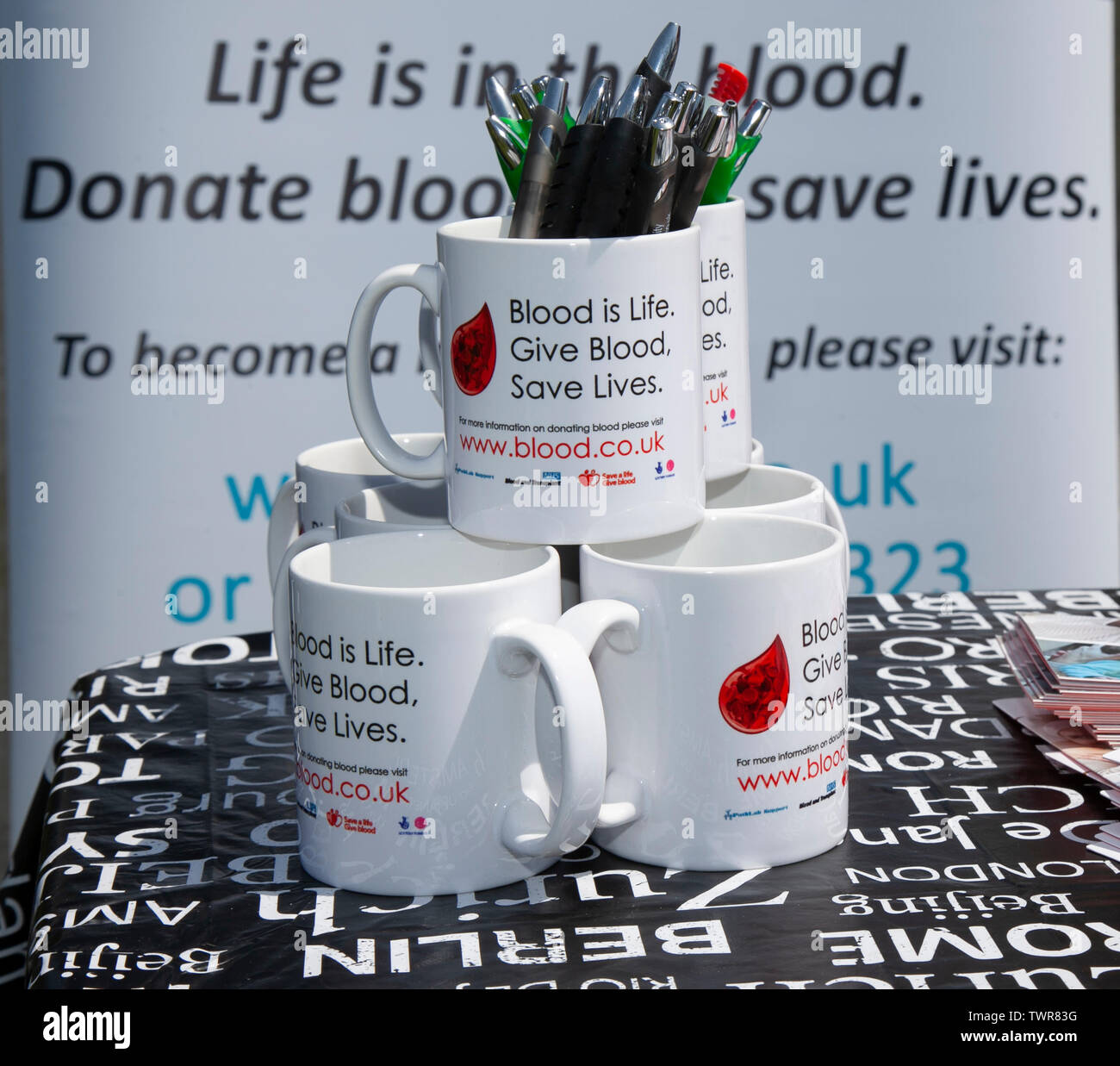 Donate Blood to save lifes, Cups and merchandise at Africa Oye, Sefton Park, Liverpool, UK - Stock Image