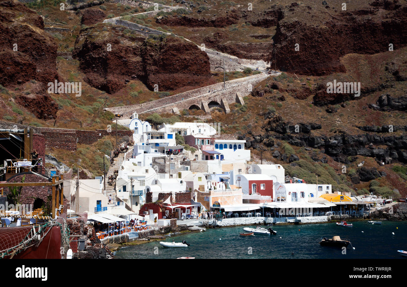 harbor town of Ammoudi Bay with the town of Oia above it on the island of Santorini, Greece Stock Photo