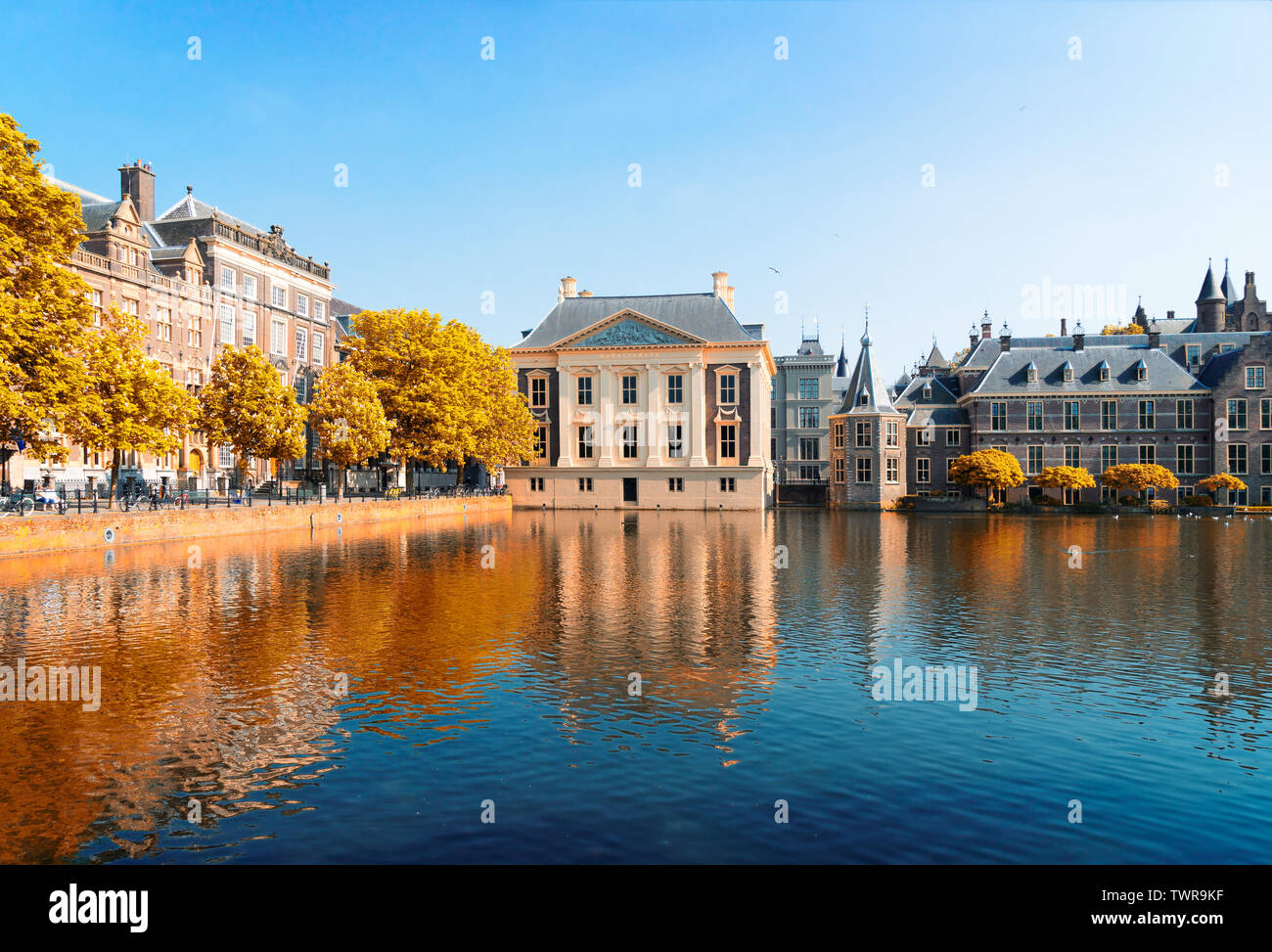 city center of Den Haag - Dutch pairlament, Mauritshuis and with reflections in pond, Netherlands at fall - Stock Image