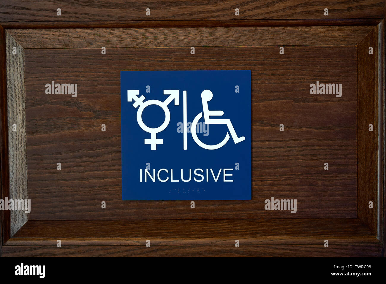 ADA Compliant Gender Inclusive Symbol Restroom Wall Sign with Wheelchair Symbol and braille - Stock Image