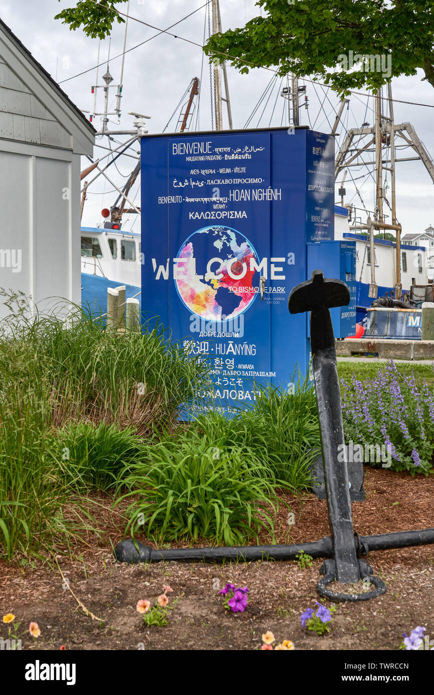 Hyannis, MA - June 10, 2019: Sign at the harbor says welcome in many languages from around the world. - Stock Image