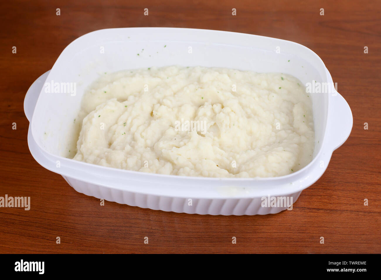 Large dish of creamy mashed potatoes prepared with chives - Stock Image