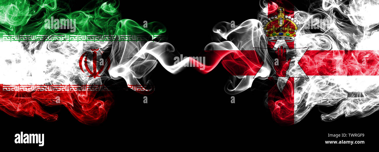 Iran vs Northern Ireland smoky mystic states flags placed side by side. Thick colored silky smokes flag combination of Iranian and Northern Ireland - Stock Image
