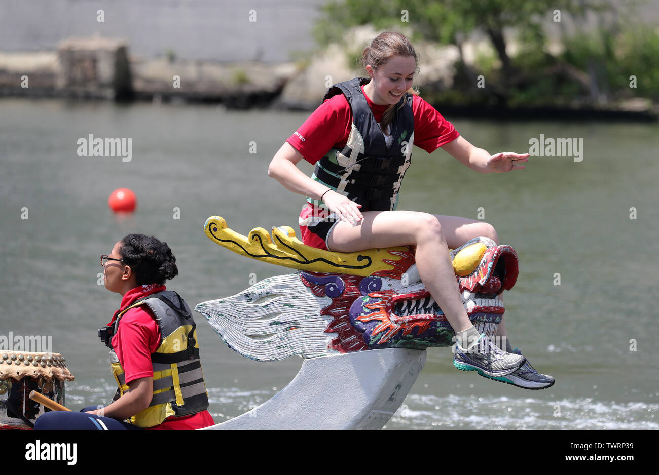 Chicago, USA. 22nd June, 2019. A participant smiles after her team won a round of game in a dragon boat race in Chicago, the United States, on June 22, 2019. The 2019 Chicago Dragon Boat Race kicked off on the south branch of the Chicago River Saturday morning, with 34 dragon boat teams participating in this year's competition. Credit: Wang Ping/Xinhua/Alamy Live News - Stock Image