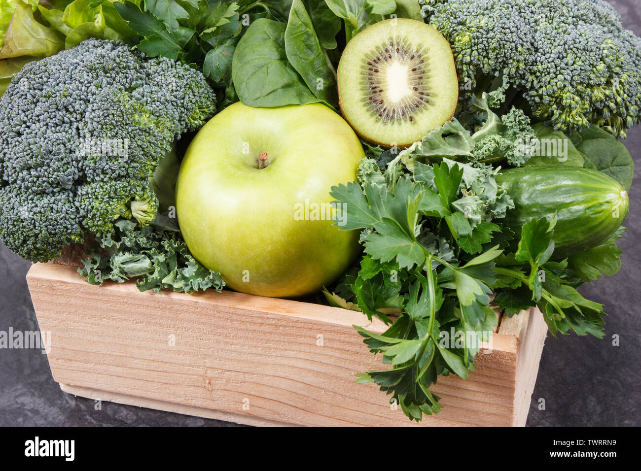 Fresh ripe green fruits with vegetables as healthy food containing natural vitamins or minerals. Body detox concept - Stock Image