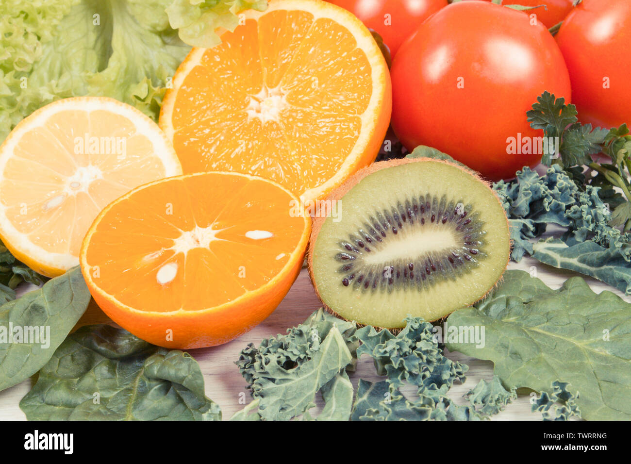 Fresh ripe fruits with vegetables as healthy nutritious snack containing natural vitamins - Stock Image