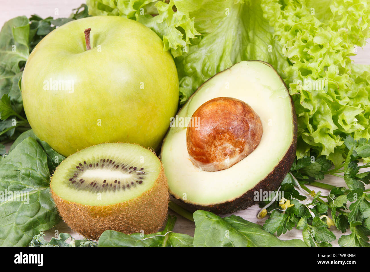 Fresh ripe fruits with vegetables and sprouts as healthy nutritious snack containing natural vitamins - Stock Image