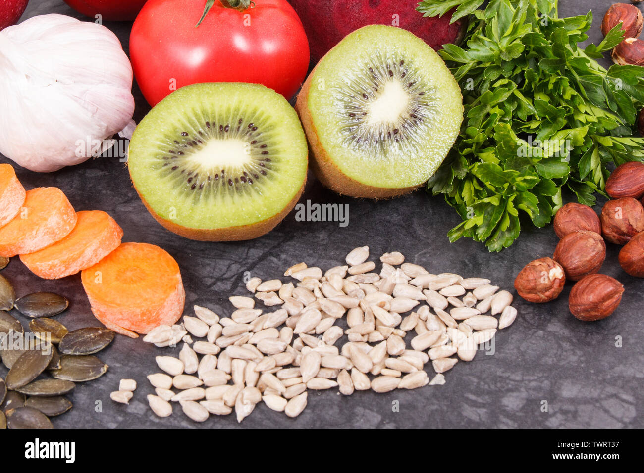 Healthy eating containing natural vitamins and minerals. Concept of best food for gout and kidneys health - Stock Image