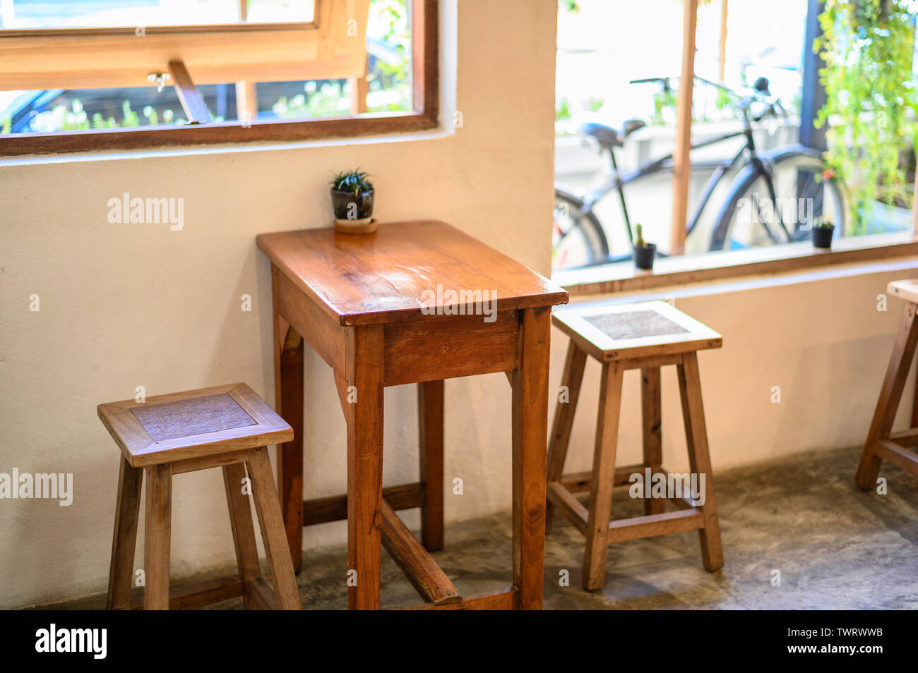 Wooden Table And Chairs For Customers In Coffee Shop Stock Photo Alamy