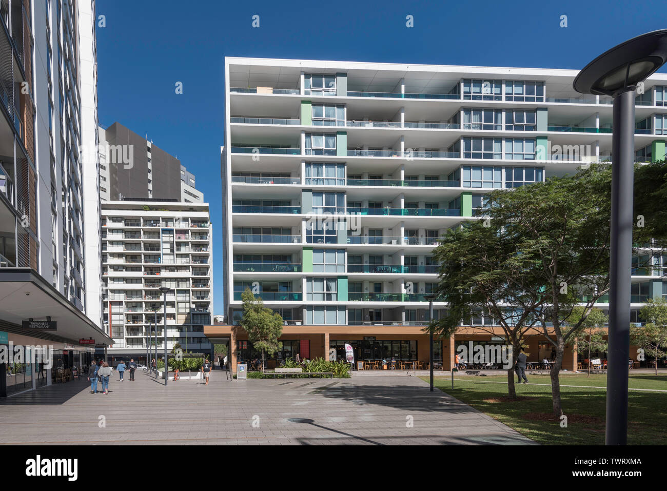 A central town square green space, part of the Discovery Point development of high rise accommodation and apartments at Wolli Creek, Sydney, Australia - Stock Image