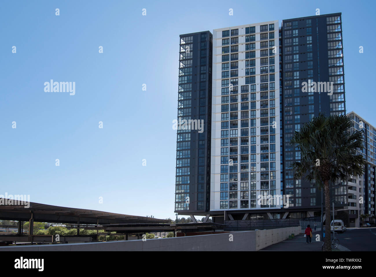 A high rise apartment building built directly over a railway line in the Sydney suburb of Wolli Creek, Australia Stock Photo