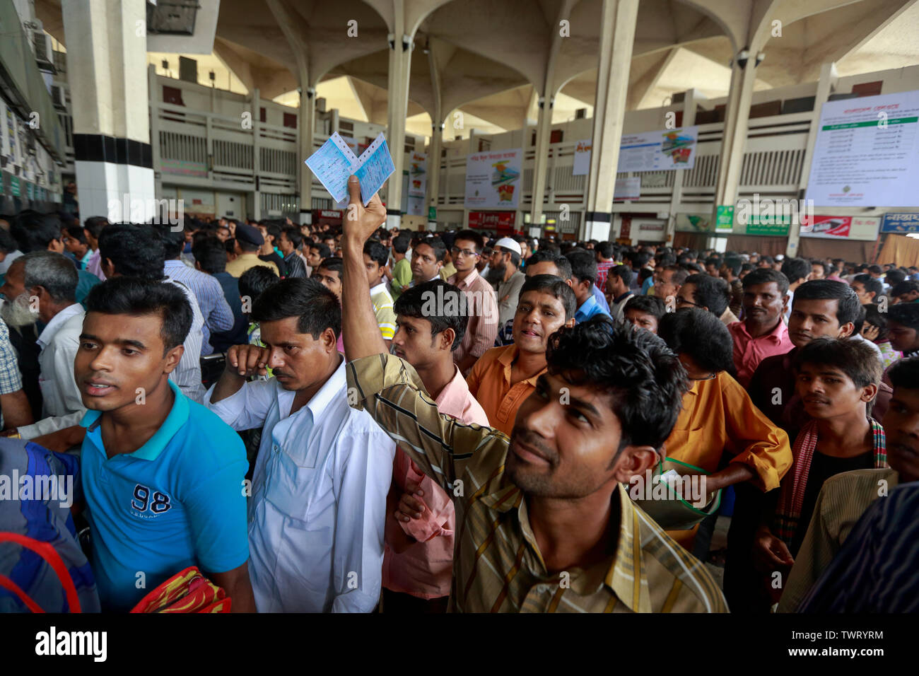 A Man smiles after securing his advanced train tickets for going home in the Eid vacation at Kamlapur railway station, Dhaka, Bangladesh. - Stock Image