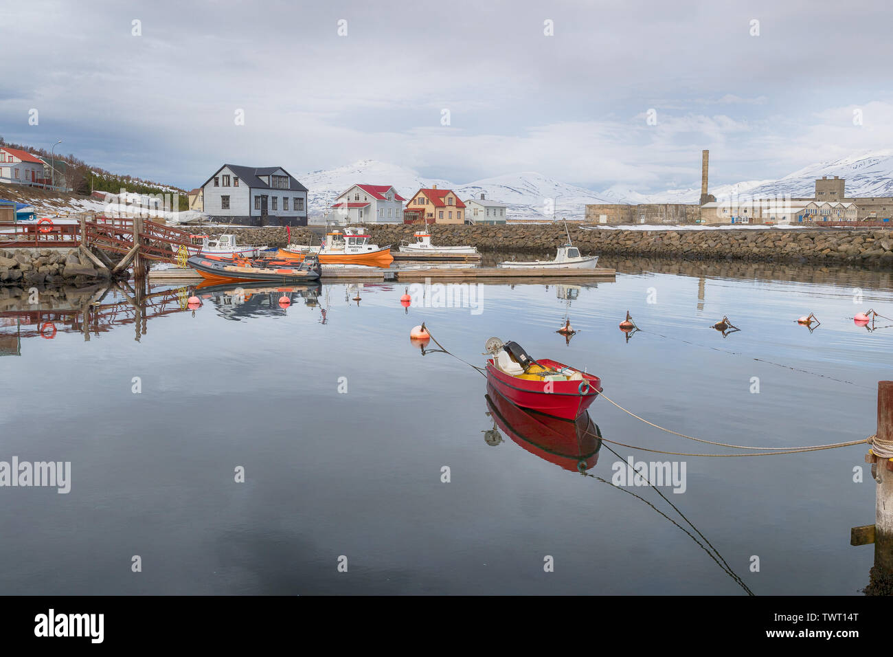A boat moored up in Hjalteyri harbour, Iceland - Stock Image