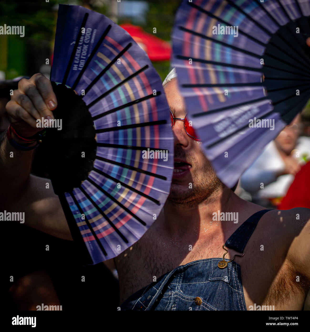 Chicago, Illinois, USA. 22nd June, 2019. Grant hides behind a fan dance on a sweaty Chicago Saturday; at Roscoe's Tavern, a few blocks from Pride Fest Credit: Chris Riha/ZUMA Wire/Alamy Live News - Stock Image