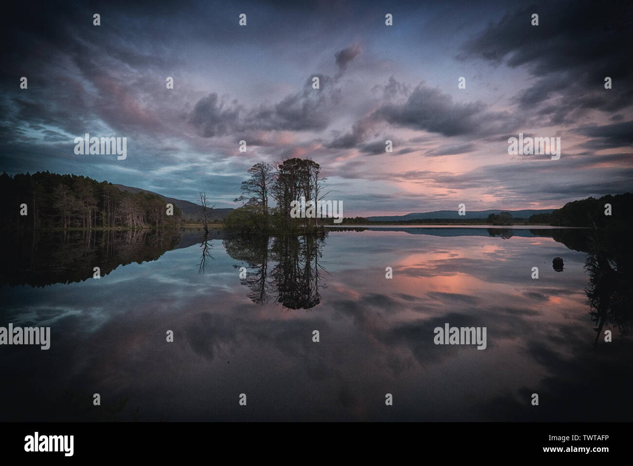 Purple Sky Reflections in Loch Mallachie - Stock Image