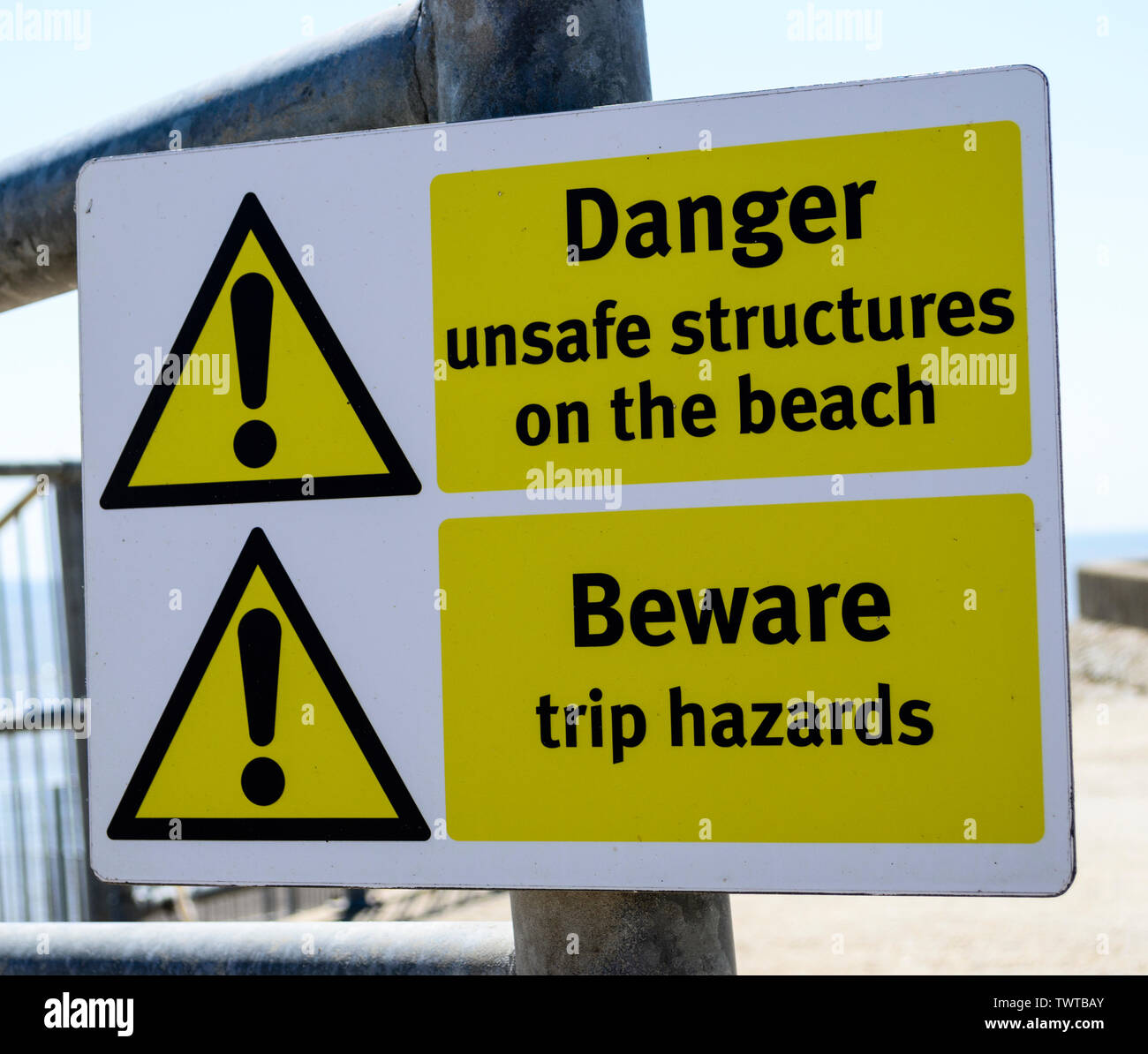 signs warning of unsafe structures on the beach UK Stock Photo