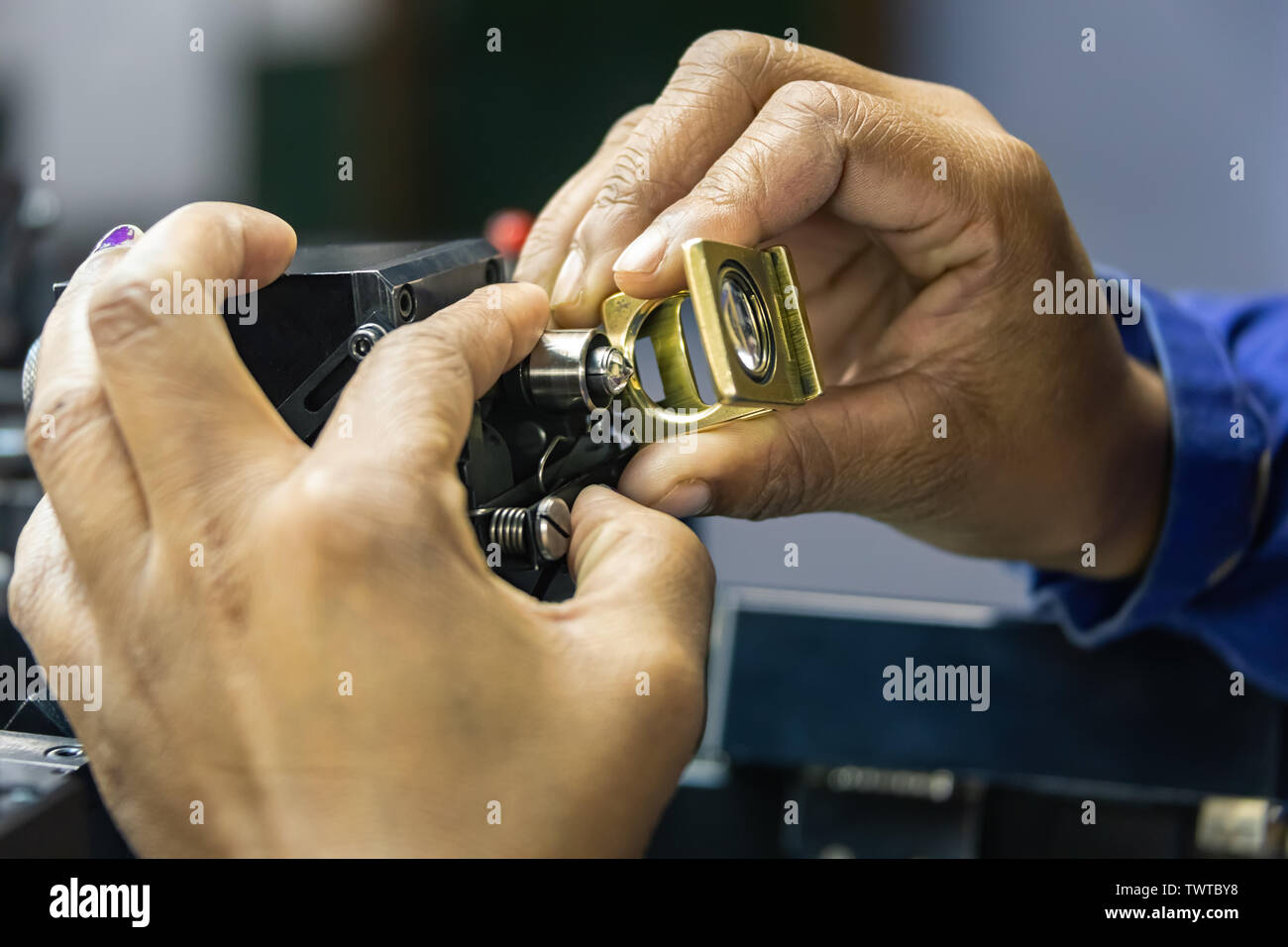 grading clarity on diamonds, microscope and magnifying glass, african woman working - Stock Image